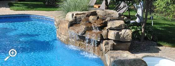 In-ground swimming pool waterfall